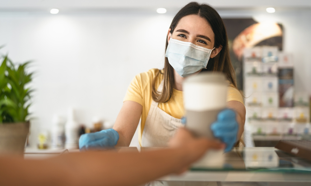 Smiling woman wearing PPE